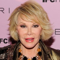 Joan Rivers short hairstyle with side swept pony