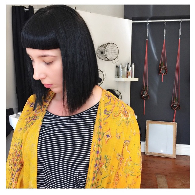short straight dull black bob hairstyle with dull bangs